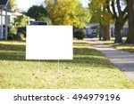 Small photo of blank yard sign during sunny autumn weather