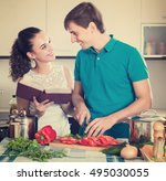young husband helping female to ... | Shutterstock . vector #495030055