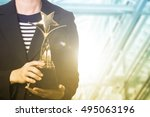 holding trophy awards after... | Shutterstock . vector #495063196
