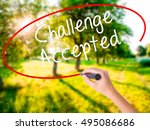 Small photo of Woman Hand Writing Challenge Accepted on blank transparent board with a marker isolated over green field background. Business concept. Stock Photo