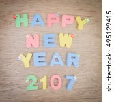 happy new year 2017 on a wood... | Shutterstock . vector #495129415