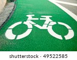 Empty green cycle track with bike lane sign - stock photo