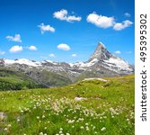 Small photo of Views of the mountain Matterhorn with cottongrass on meadow in the foreground, Pennine alps in Switzerland.