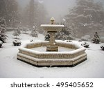 Snowfall In The Park. Fountain...