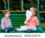Little Girl Eating Cotton Cand...