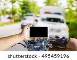 man using a cell phone while... | Shutterstock . vector #495459196