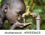 water is life  african baby boy ... | Shutterstock . vector #495553615