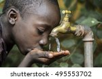 little african boy drinking... | Shutterstock . vector #495553702