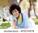 beautiful woman blowing bubbles ... | Shutterstock . vector #495574978