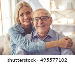 handsome old man and beautiful... | Shutterstock . vector #495577102