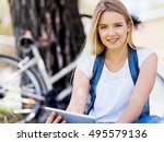 young woman using tablet in the ... | Shutterstock . vector #495579136