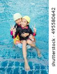 baby girls asia enjoy swimming... | Shutterstock . vector #495580642