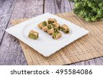 arabic desserts  with nuts... | Shutterstock . vector #495584086