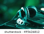 headphones on cd music disc... | Shutterstock . vector #495626812