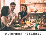 dinning with friends. cheerful... | Shutterstock . vector #495638692