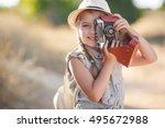 small child girl holding camera ... | Shutterstock . vector #495672988