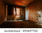 Stock photo abandoned hotelroom with a chair and red light in germany 495697702