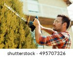 hedge trimming works in a... | Shutterstock . vector #495707326