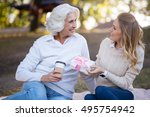two emotional pleasant women... | Shutterstock . vector #495754942