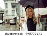 cheerful woman in the street... | Shutterstock . vector #495771142