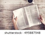 young woman reading newspaper | Shutterstock . vector #495887548