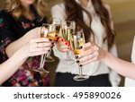 hands holding the glasses of... | Shutterstock . vector #495890026