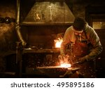 The Blacksmith Forging The...