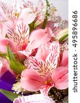Small photo of Bouquet of Alstroemeria close up macro background