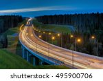 Night lighting a road overpass in the woods. - stock photo