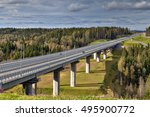 Highway bridge over russian forest in landscape, sunny summer day. - stock photo