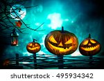 halloween pumpkins in front of... | Shutterstock . vector #495934342