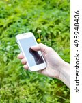 smartphone in hand at the park | Shutterstock . vector #495948436