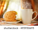 Hot Drink And Biscuit With A...