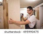 man polishes boards. carpenter... | Shutterstock . vector #495990475