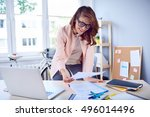 busy businesswoman working by... | Shutterstock . vector #496014496