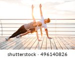 smiling couple doing yoga... | Shutterstock . vector #496140826