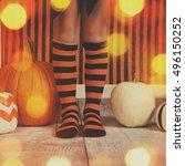 a little girl is wearing black... | Shutterstock . vector #496150252