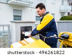 postman delivering letters to... | Shutterstock . vector #496261822