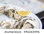 tasty oysters on ice with lime | Shutterstock . vector #496263496