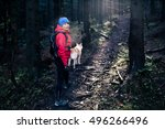 woman hiking with akita inu dog ... | Shutterstock . vector #496266496