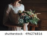 the bride is holding a wedding... | Shutterstock . vector #496276816