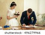 Gorgeous Bride   Groom Signing...