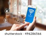 using smart home app on phone.... | Shutterstock . vector #496286566
