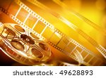 cinema film reel  gold colors  | Shutterstock . vector #49628893