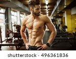 muscular bodybuilder at a gym. | Shutterstock . vector #496361836