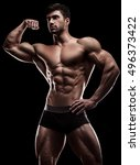 bodybuilder in a pose on a... | Shutterstock . vector #496373422
