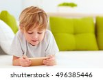 cute kid playing games on... | Shutterstock . vector #496385446