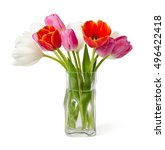 The Tulips In A Vase Are...