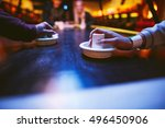hands of young people holding... | Shutterstock . vector #496450906