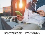 man with credit card and mobile ... | Shutterstock . vector #496490392